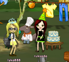 The cake is next to the chef in Explorer\'s Camp